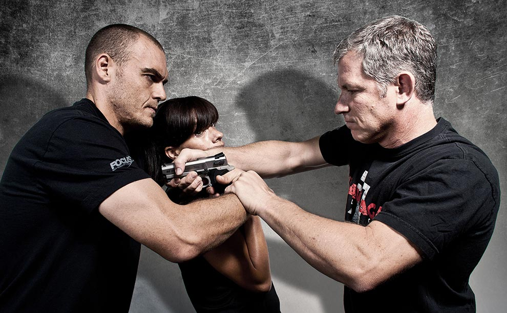 Image showing Krav Maga seminar student disarming attacker who has woman hostage